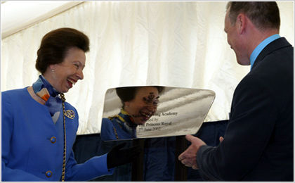 Royal approval. Princess Anne receives a gift from Rolls-Royce, engraved by Uppermost.